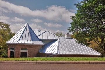 Steel Roof On Brick Home With Turret Design
