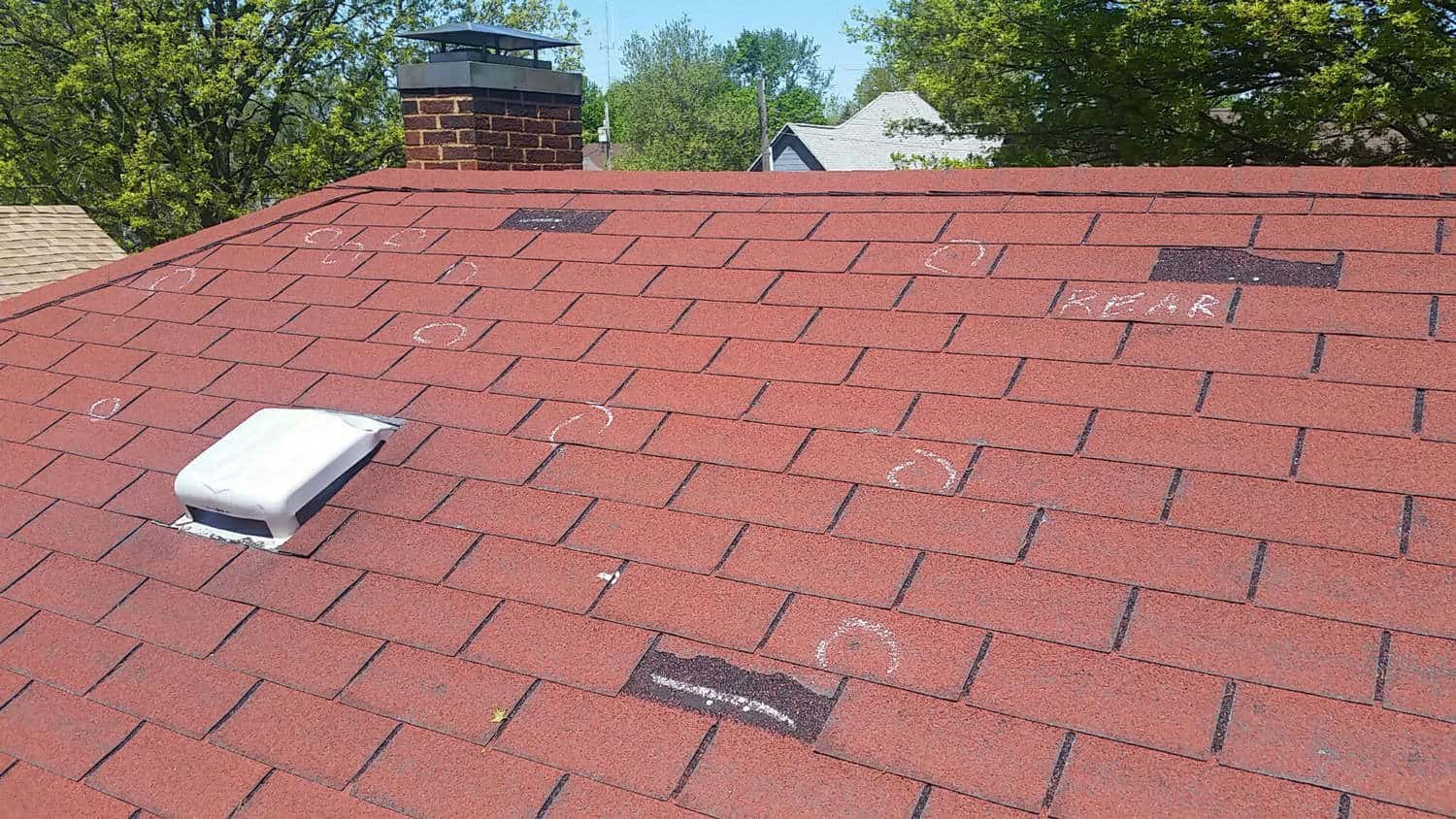 Hail Damage On A Red Asphalt Roof